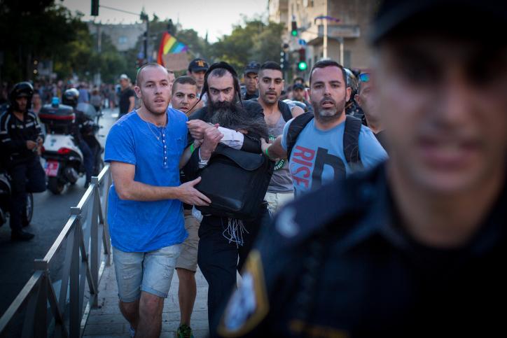 Police arrest Yishai Schlissel, who stabbed six people at the 2015 Jerusalem Pride Parade, killing 16-year-old Shira Banki, July 30, 2015. (Flash90)
