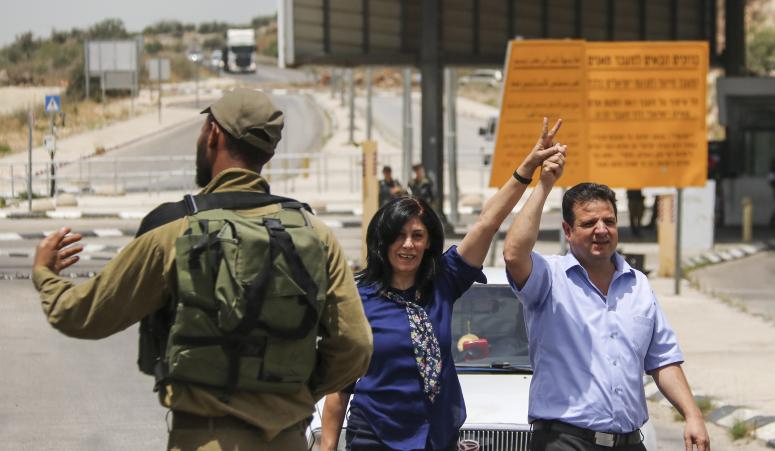 Palestinian lawmaker member Khalida Jarrar (PFLP) who was imprisoned by Israel is seen alongside Joint List head Ayman Odeh upon her release from an Israeli prison, Jabara checkpoint near the West Bank town of Tulkarem, June 3, 2016. (Haytham Shtayeh/Flash90)