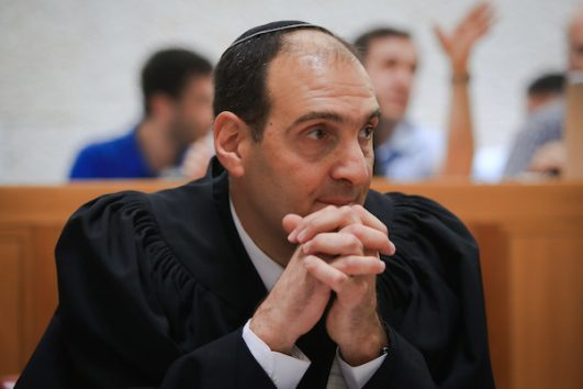 Harel Arnon, the private attorney hired by the Israeli government to defend the 'Formalization Law' before the High Court on Sunday, June 3, 2018. (Yonatan Sindel/Flash90)