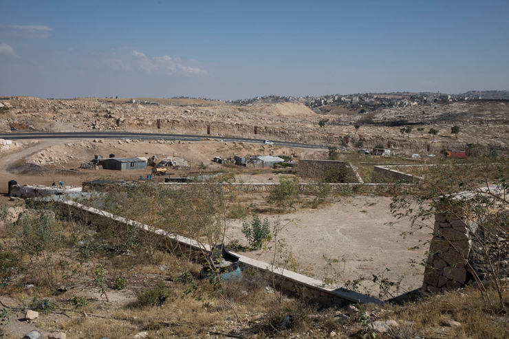 A view of the empty, barren plots in Al-Jabal, intended for Bedouin families Israel hopes to soon expel from Khan al-Ahmar, June 12, 2018. (Oren Ziv/Activestills.org)