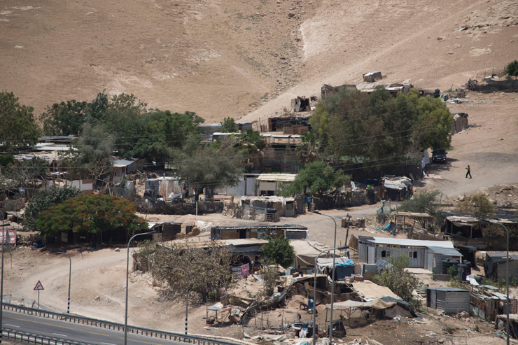 The Palestinian Bedouin village of Khan al-Ahmar, the entirety of which the Israeli army wants to demolish and forcibly displace its residents, June 11, 2018. (Oren Ziv/Activestills.org)