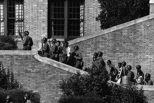 U.S. Army soldiers escort the Little Rock Nine students into the all-white Central High School in Little Rock, Arkansas, 1957. (U.S. Army)
