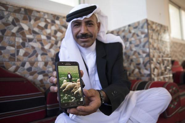 Salah holds a picture of himself herding sheep. al-Jabal, June 12, 2018. (Oren Ziv / Activestills.org)