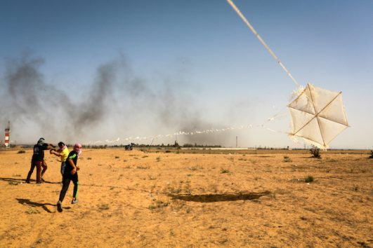 Palestinians prepare a kite that will be attached to flammable materials to be flown toward Israel during a demonstration on the Gaza-Israel border, in east Rafah, in the southern Gaza Strip, on June 22, 2018. (Abed Rahim Khatib/Flash90)
