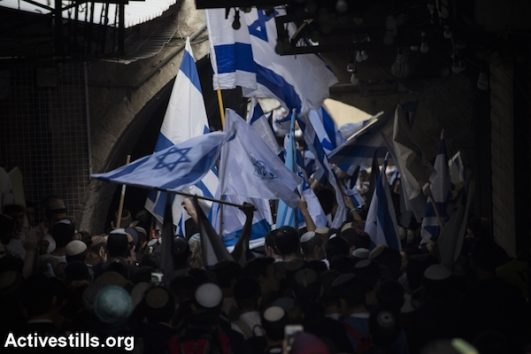 Right-wing Jewish Israelis march through the Muslim Quarter of Jerusalem's Old City. May 13, 2018. (Oren Ziv / Activestills.org)