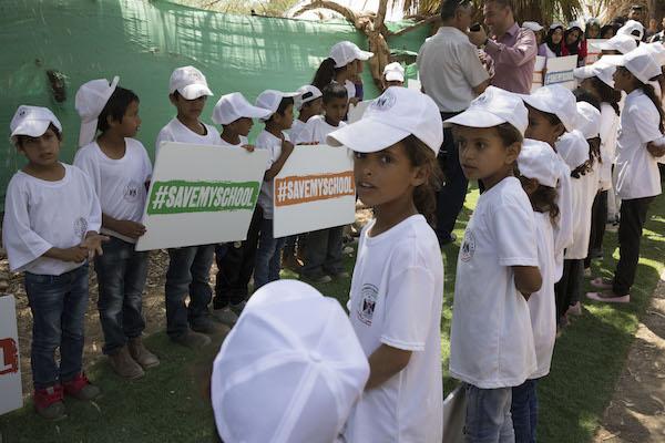 "Children demonstrate outside the ""Tire School"" in the Palestinian Bedouin village of Khan al-Ahmar. June 11, 2018. (Oren Ziv/Activestills.org)"