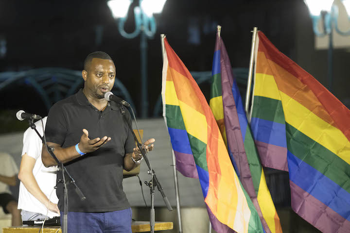 Ethiopian anti-racist activist Avi Yalou speaks during the first ever Jewish-Arab pride event in the central city of Lod, July 26, 2018. (Oren Ziv/Activestills.org)