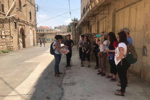 Jewish American Birthright participants who walked off the tour to learn about the occupation with left-wing Israeli groups, take part in a Breaking the Silence tour of occupied Hebron, July 16, 2018. (Mairav Zonszein)