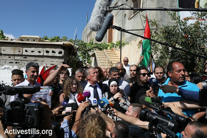 Ahed Tamimi, Bassem Tamimi, and Nariman Tamimi give a short statement to media outlets and supporters after the release of Ahed and Nariman from Israeli prison, Nabi Saleh, West Bank, July 29, 2018. (Oren Ziv/Activestills.org)