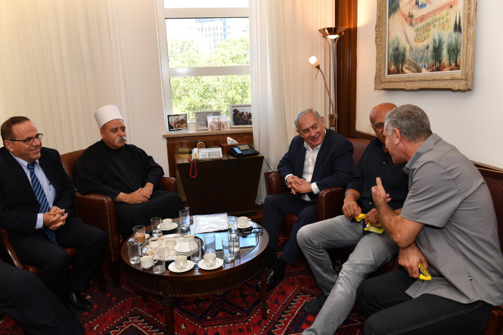 Prime Minister Benjamin Netanyahu meets with leader of the Druze community in Israel, Sheikh Mowafaq Tarif, at the Prime Minister's Office in Jerusalem, July 27, 2018. (Kobi Gideon/GPO)