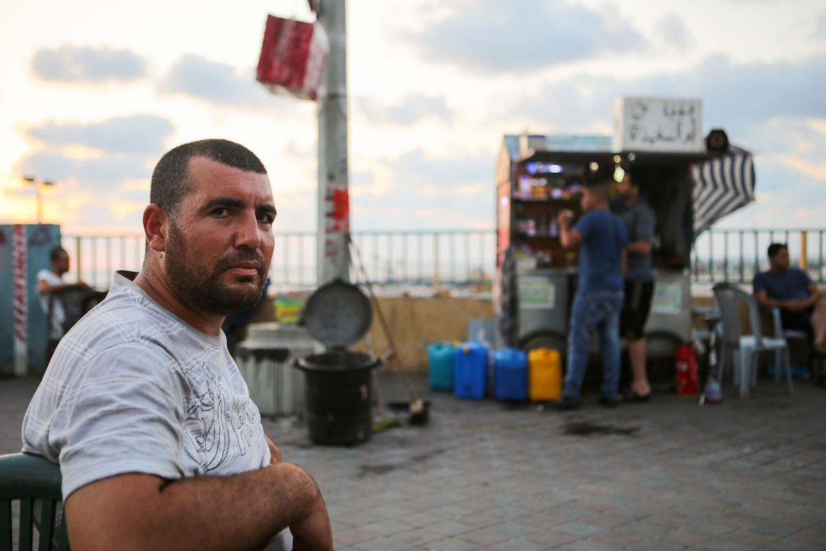 Ibrahim Massoud has spent much of the last 10 years as a street vendor, ever since he lost his job at a slaughterhouse. 'Most street vendors ended up at the sea after they lost their jobs. The poor and rich in Gaza are turning to the beach to let out their concerns.' (Mohamed Al Hajjar)