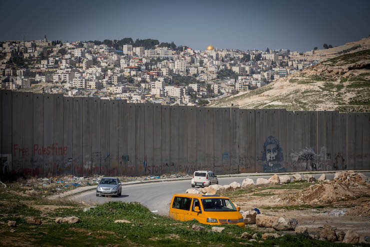 A view of Jerusalem behind Israel's separation wall, as seen from Abu Dis, West Bank, February 26, 2017. (Miriam Alster/Flash90)
