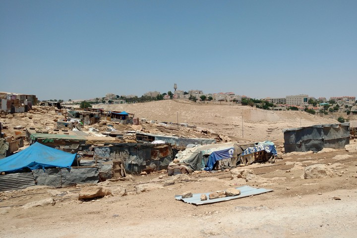 The Bedouin village of Abu Nuwar, in the E1 area of the West Bank. In the background are the southern neighborhoods of Kedar and Ma'ale Adumim, two Israeli settlements near Jerusalem. (Orly Noy)