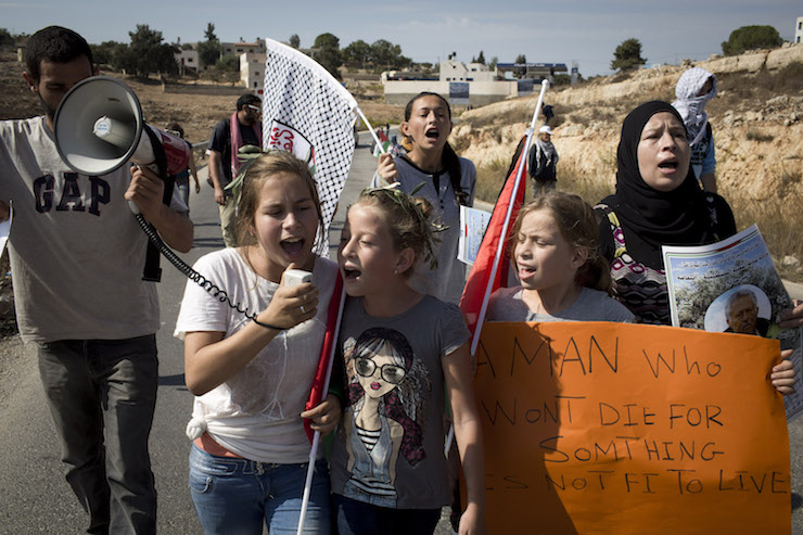 Nariman Tamimi (right) leads a protest in the West Bank village of Nabi Saleh, October 19, 2012. (Oren Ziv)