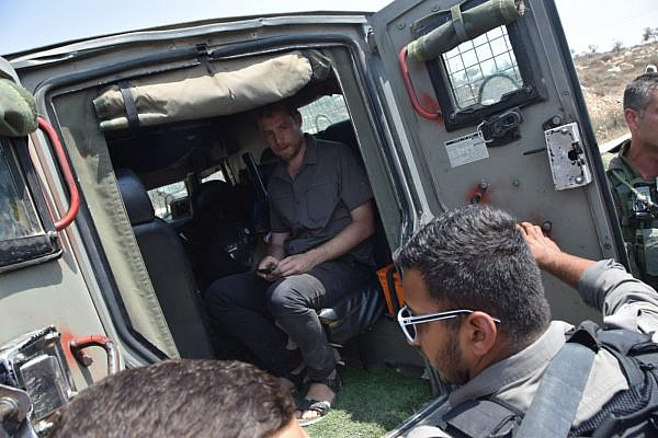 Israeli soldiers detaining Avner Gvaryahu, director of Breaking the Silence, on a tour of the South Hebron Hills, August 31, 2018. (Nasser Nawaja, B'Tselem)