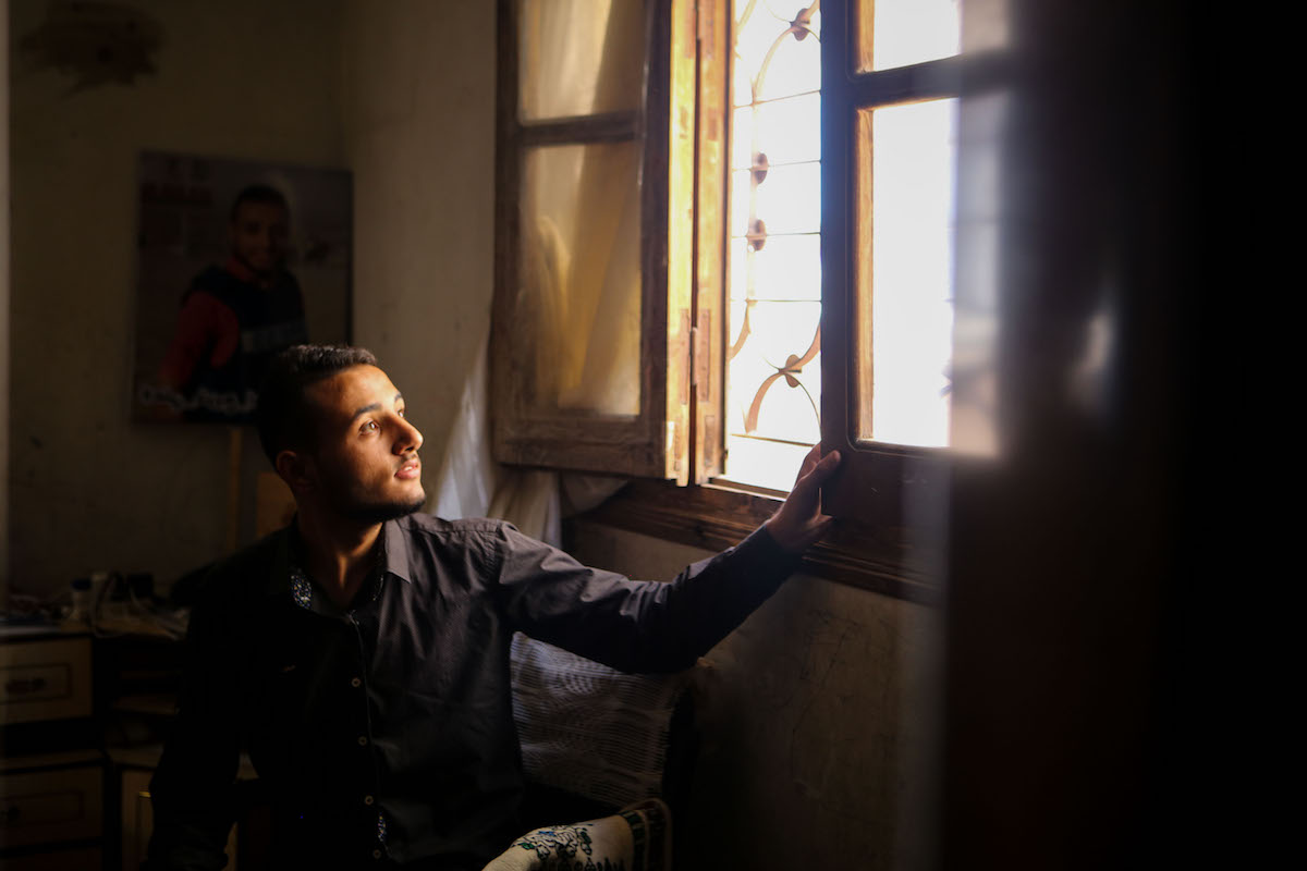 Ali Akram Abu Shanab, 21, from Shuja'iyya, Gaza, had difficulty continuing his secondary education due to trauma from the 2014 Gaza war. In July, he graduated with excellence from the University College of Applied Science. (Mohamed Al Hajjar)