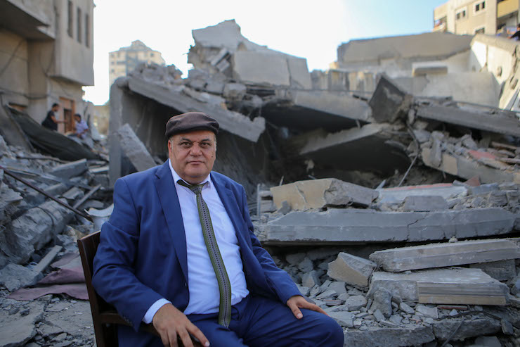 Gaza director Ali Abu Yassin sits among the ruins of Gaza's Al-Meshal Cultural Center, which was bombed by Israel on August 8, 2018. (Mohamed Al Hajjar)