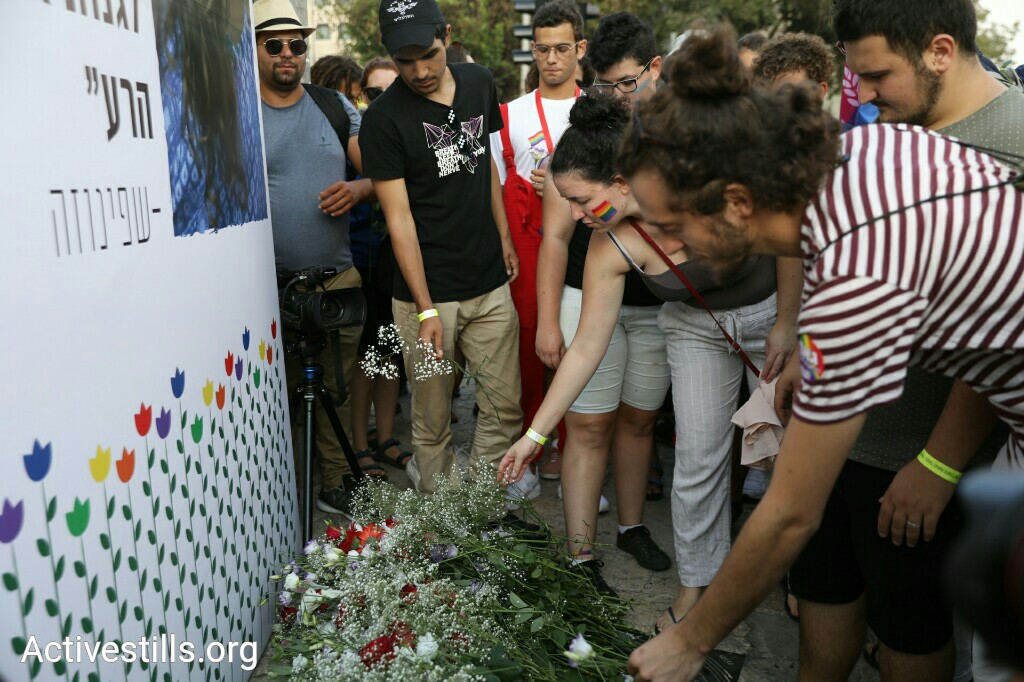 Participants in the annual Jerusalem Pride March lay flowers on the memorial for Shira Banki, who was stabbed and killed by a religious extremist during the 2015 march. (Oren Ziv/Activestills.org)