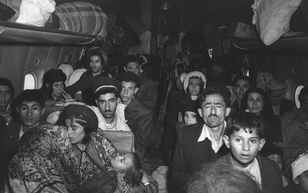 A plane filled with Iraqi Jews photographed on arrival at Lod Airport in early 1951. (Teddy Brauner, GPO)