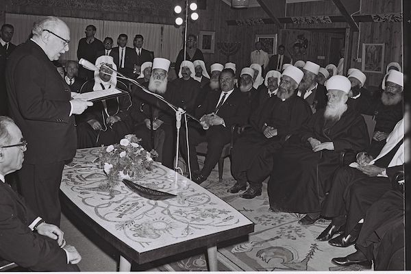 Israeli President Zalman Shazar welcomes a group of Druze notables at the President's home in Jerusalem for the Muslim holiday of Eid al-Adha, April 4, 1968. (Fritz Cohen/GPO)