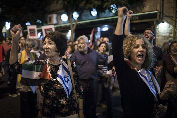 Palestinian and Israeli peace activists march in central Jerusalem on October 17, 2015. (Hadas Parush/Flash90)