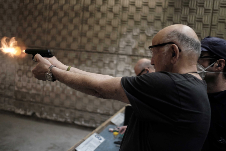 Israelis practice shooting handguns at the Olympic Shooting Range in Herzeliya, following a wave of attacks in Jerusalem and Israel, October 18, 2015. (Tomer Neuberg/Flash90)