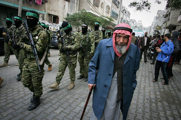 Members of the Izz ad-Din al-Qassam Brigades, the military wing of Hamas, take part in a rally ahead of the 30th anniversary of the movement's founding on December 5, 2017, Khan Younis, Gaza Strip. (Abed Rahim Khatib/Flash90)