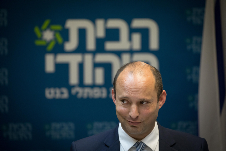 Head of the Jewish Home party, Naftali Bennett, leads a faction meeting in the Israeli parliament on June 25, 2018. (Yonatan Sindel/Flash90)