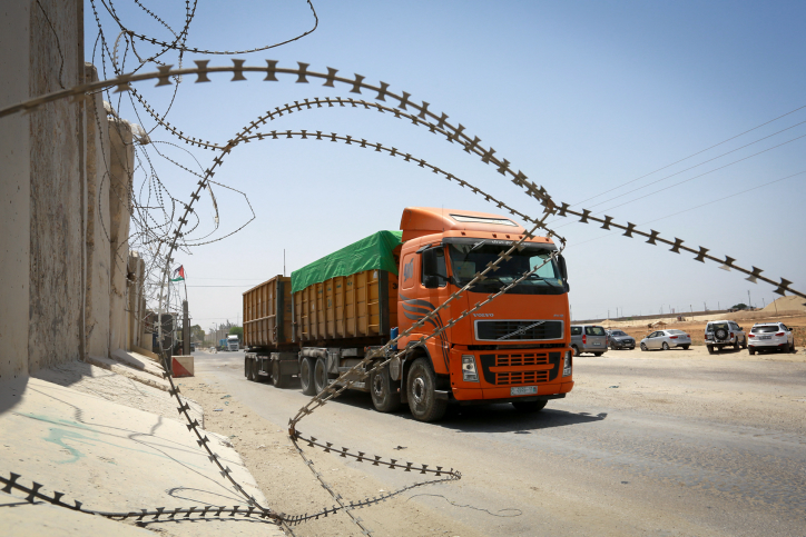Trucks at the Kerem Shalom crossing, the main passage point for goods entering Gaza from Israel, in the southern Gaza Strip town of Rafah, following a partial reopening of the crossing point on July 24, 2018. (Abed Rahim Khatib/ Flash90)