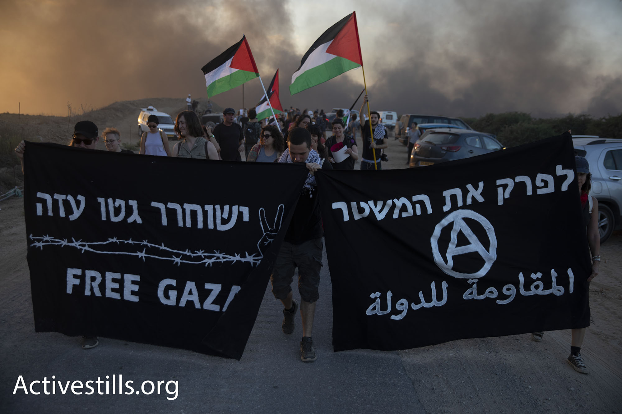 For many of the activists, the ability to come and witness first hand what is going on beyond the fence, inside Gaza, was an important goal in itself. (Oren Ziv/Activestills.org)