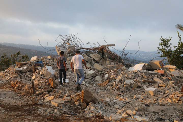 Palestinians inspect the home of Muhammad Dar Yusuf, which was demolished by the Israeli military in the West Bank village of Kobar near Ramallah, on August 28, 2018. Dar Yusuf murdered 31-year-old Yotam Ovadia in the West Bank Settlement of Adam. (Flash90)