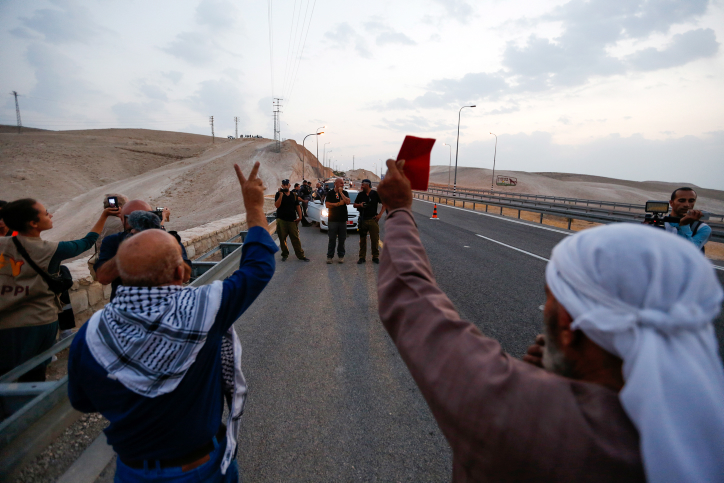 Activists protest the demolition of Wadi al-Ahmar near the Bedouin village of Khan al-Ahmar in the West Bank on September 12, 2018. (Wisam Hashlamoun/Flash90)