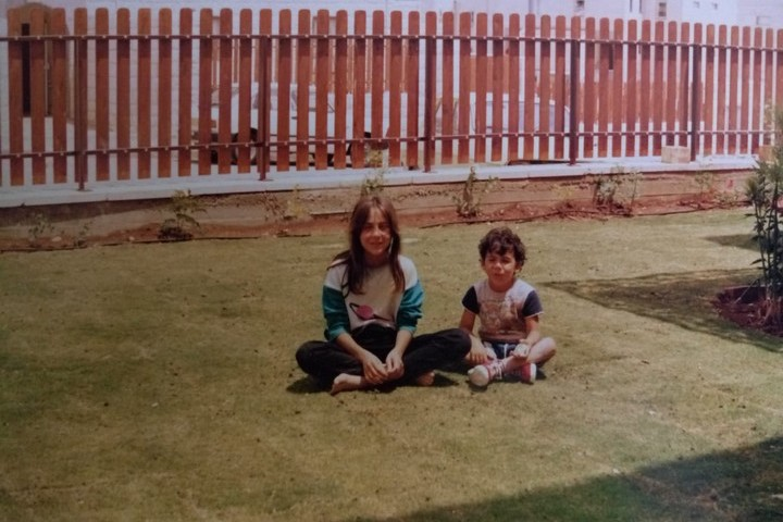 Ofer and his sister seen in their childhood home in Pisgat Ze'ev.