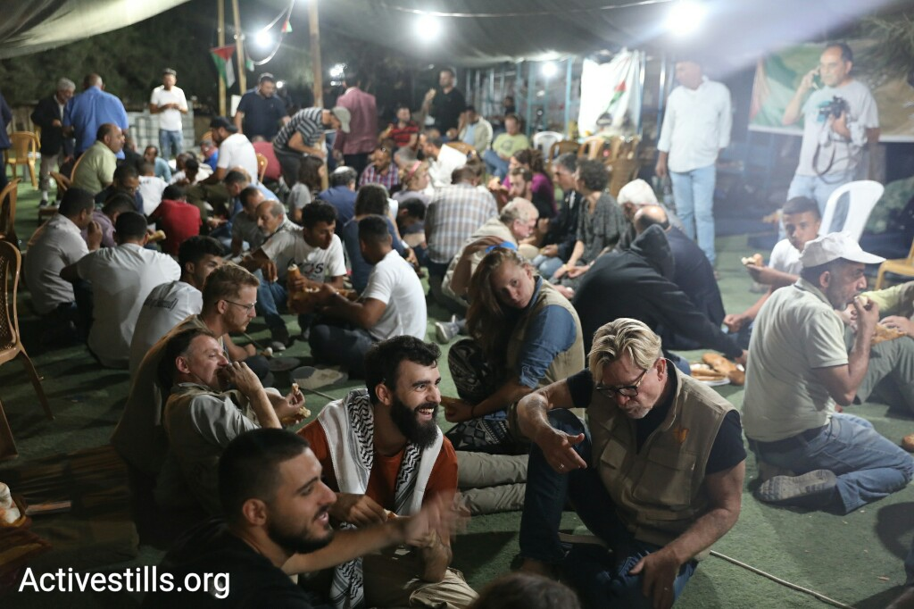 A hundred or so Palestinian, Israeli and international activists are maintaining a presence n Khan al-Ahmar until Israeli troops come to demolish the village. (Oren Ziv)