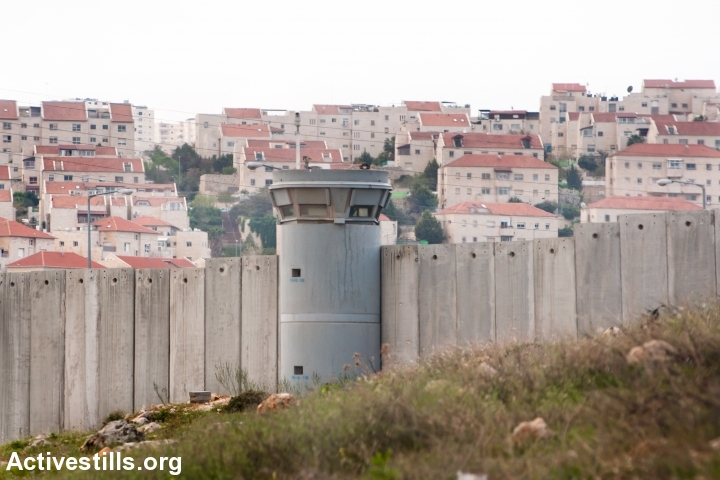The Israeli separation wall surrounds the East Jerusalem neighborhood of Pisgat Ze'ev, April 9, 2011. (Activestills.org)
