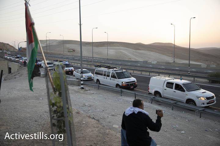 Israeli police vehicles park on the main road outside Khan al-Ahmar in the early hours of October 14, 2018. Oren Ziv/Activestills.org)