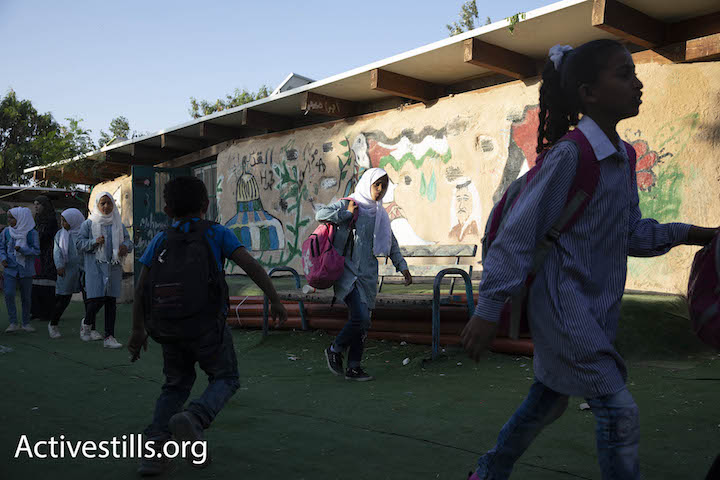 Palestinian schoolchildren begin their day at the Khan al-Ahmar eco-school, October 14, 2018. (Oren Ziv/Activestills.org)