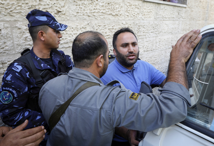 Issa Amro, a prominent Palestinian activist, is detained by Palestinian police in the West Bank town of Hebron on September 7, 2017, after criticizing the Palestinian Authority's arrest of a journalist on social media. (Wisam Hashlamoun/Flash90)