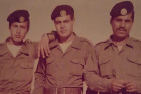 The author's father, right, in the Jordanian military service. (Photo courtesy of the author.)