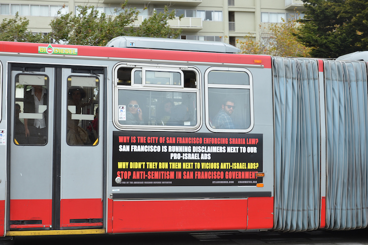 File photo of an advertisement on a San Francisco public bus accusing the city of enforcing Sharia law, paid for by the American Freedom Defense Initiative, which received funding from the SF Jewish Federation. (Steve Rhodes/CC 2.0)
