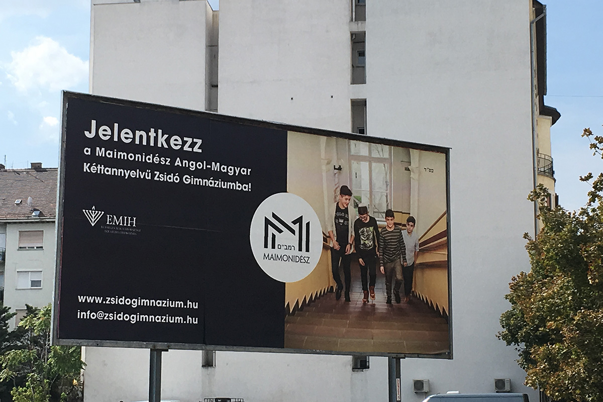 A billboard advertizing a Chabad high school in Budapest. 'The close ties between Chabad and the Orbán government 'is actually a reinforcement of the idea of ethno-culturalism,' observes Kata Vincze.' (Joshua Leifer)