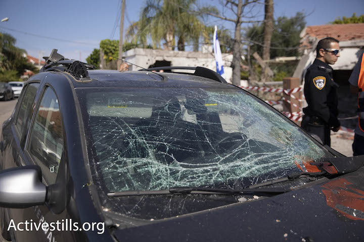 A damaged car seen in the southern Israeli city of Ashkelon, following a massive rocket attack by Palestinians in Gaza, November 13, 2018. (Oren Ziv/Activestills.org)