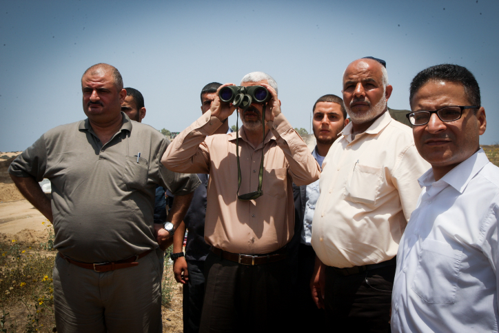 Hamas leader Yehya Sinwar inspects the border with Egypt from the Gaza Strip town of Rafah, July 6, 2017. (Abed Rahim Khatib/Flash90)