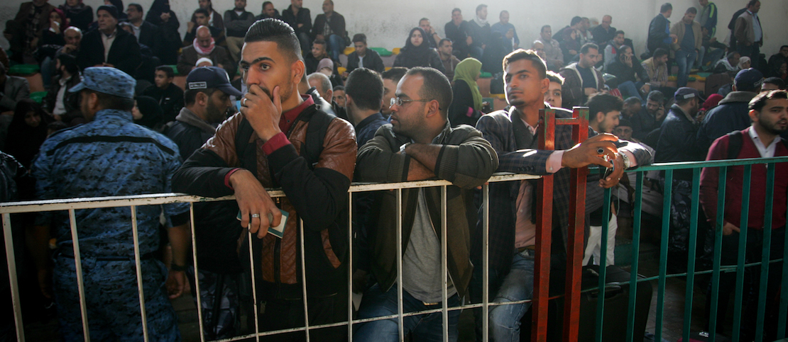 Palestinians wait for travel permits to cross into Egypt, for the first time since the Palestinian reconciliation deal, in the southern Gaza Strip on November 18, 2017. (Abed Rahim Khatib/Flash90)