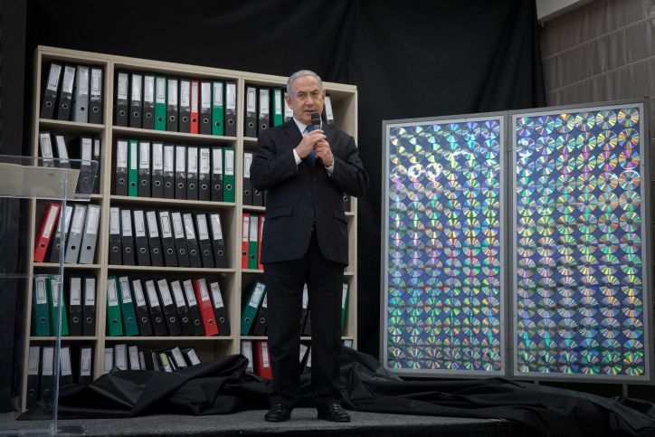 Prime Minister Benjamin Netanyahu presents files that he says prove the existence of Iran's nuclear program, during a press conference at the Kirya defense headquarters in Tel Aviv, April 30, 2018. (Miriam Alster/Flash90)