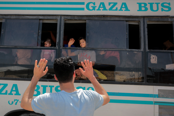 Palestinians wait to travel to Egypt through the Rafah border crossing, in the southern Gaza Strip, on May 18, 2018. (Abed Rahim Khatib/Flash90)