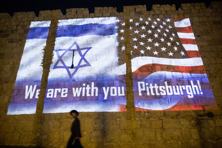 The Israeli and the American flags are screened on the walls of Jerusalem's Old City, on October 28, 2018, in solidarity with the victims who were killed in a mass shooting at Pittsburgh synagogue. (Yonatan Sindel/Flash90)