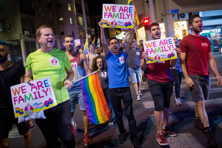 Members of the LGBTQ community and supporters participate in a protest in Tel Aviv against a Knesset bill amendment denying surrogacy for same-sex couples, on November 1, 2018, 2018. (Miriam Alster/Flash90)