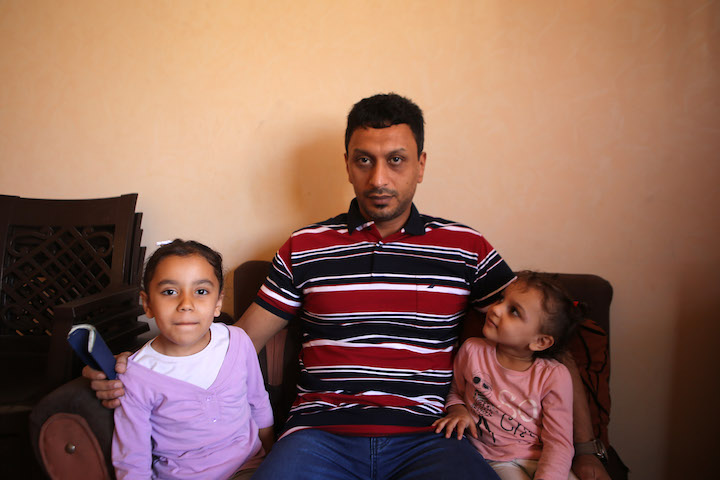 Haitham Mohammad Hussein Abu Hani and his two daughters. 'I can't travel or study abroad, I can't go on Hajj or even visit my mother in Egypt.' (Mohamed Al Hajjar)