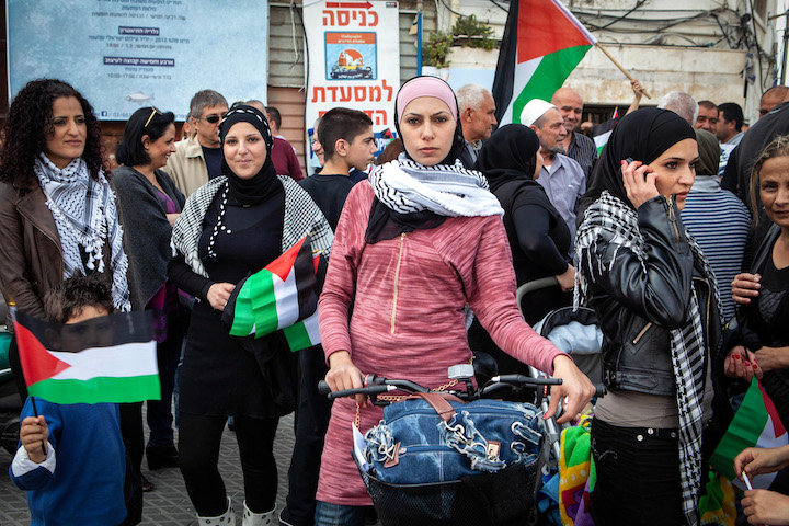 Palestinian women take part in a Land Day protest march in Jaffa, March 31, 2012. (Mati Milstein)